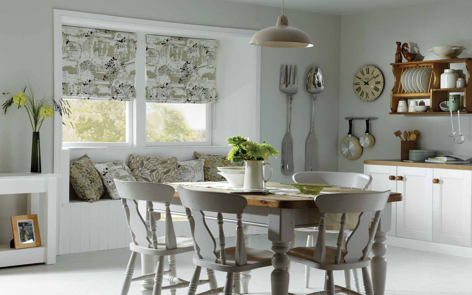 Patterned roman blinds in a kitchen