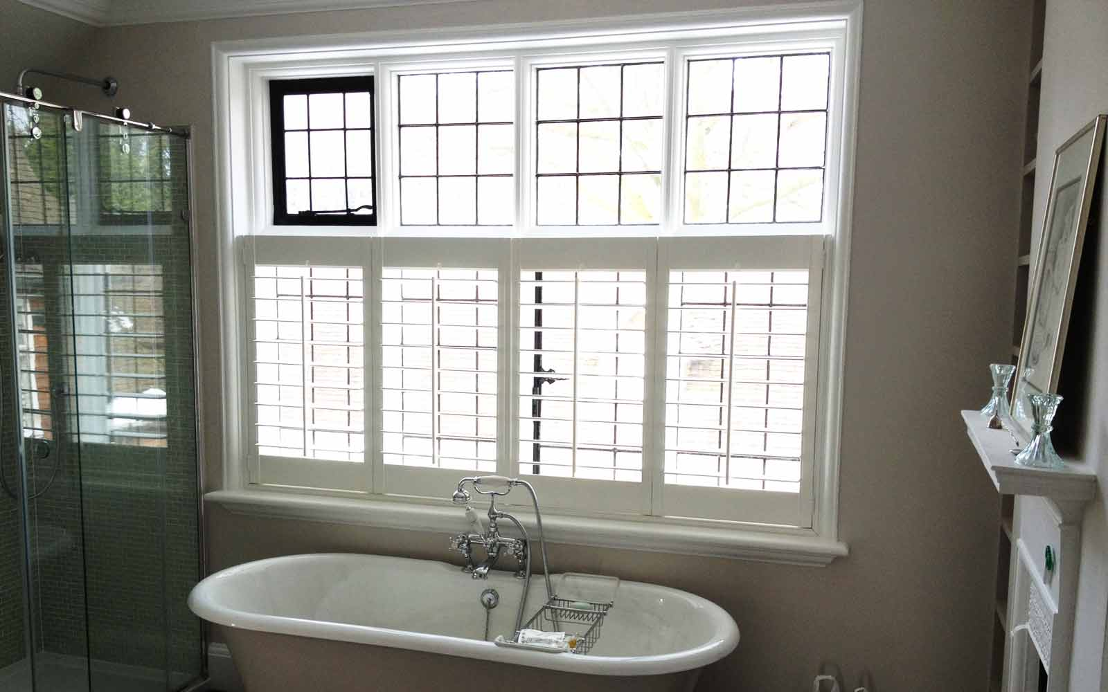 plantation shutters cafe style in a bathroom