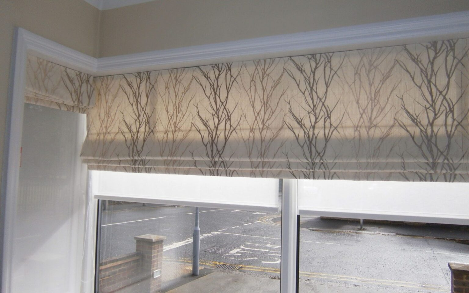 Patterned roman blinds bay window surrey blinds shutters for Roman shades for bay window