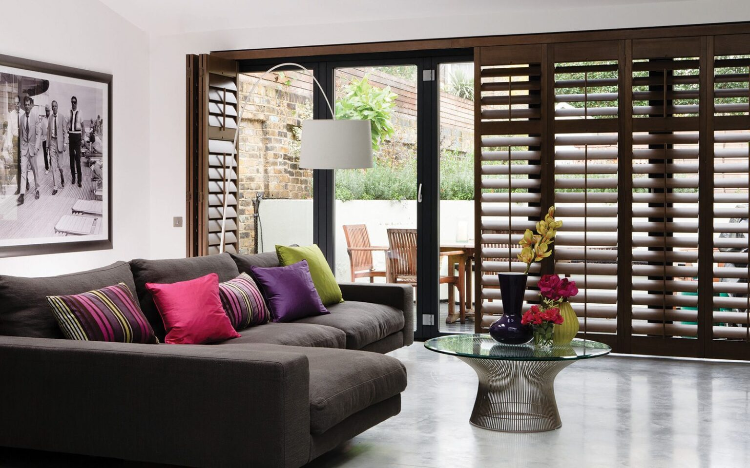 Plantation shutters Bi-fold doors in a living room