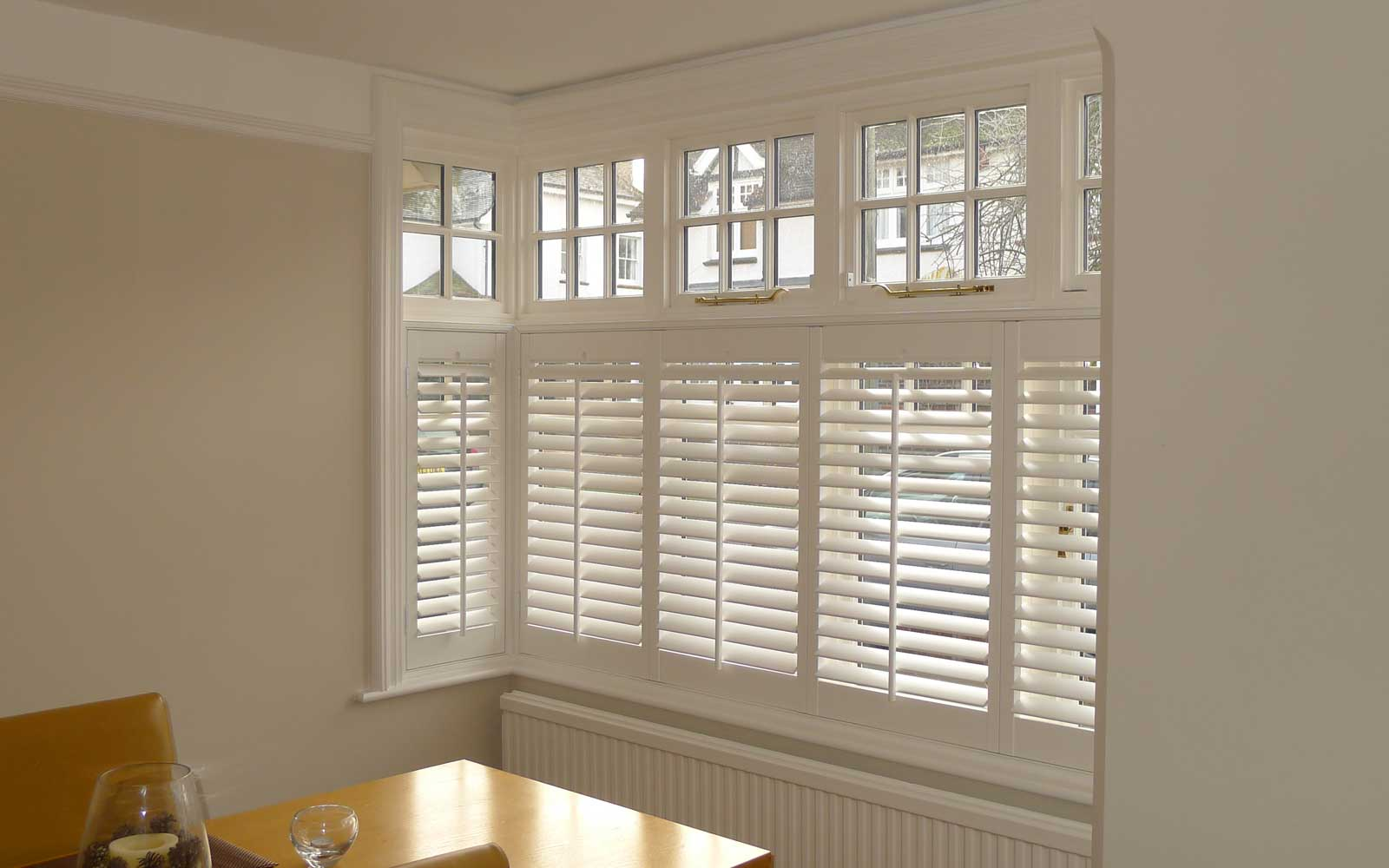 Cafe Style Shutters In A Square Bay Window Surrey Blinds