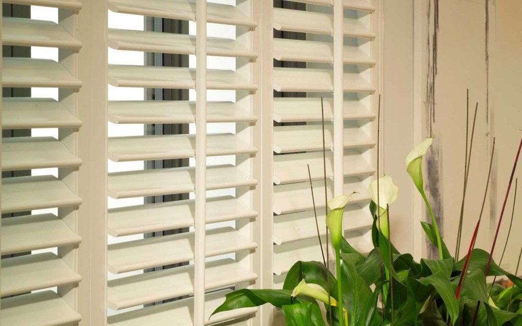 White Centre Tilt Rod Shutters