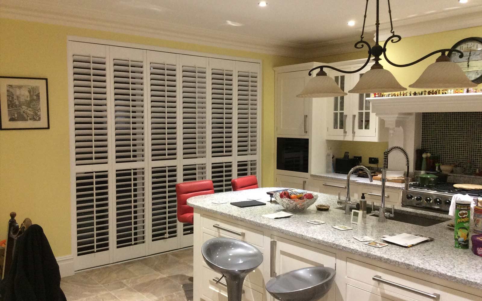 Plantation Shutters tracked doors in a kitchen