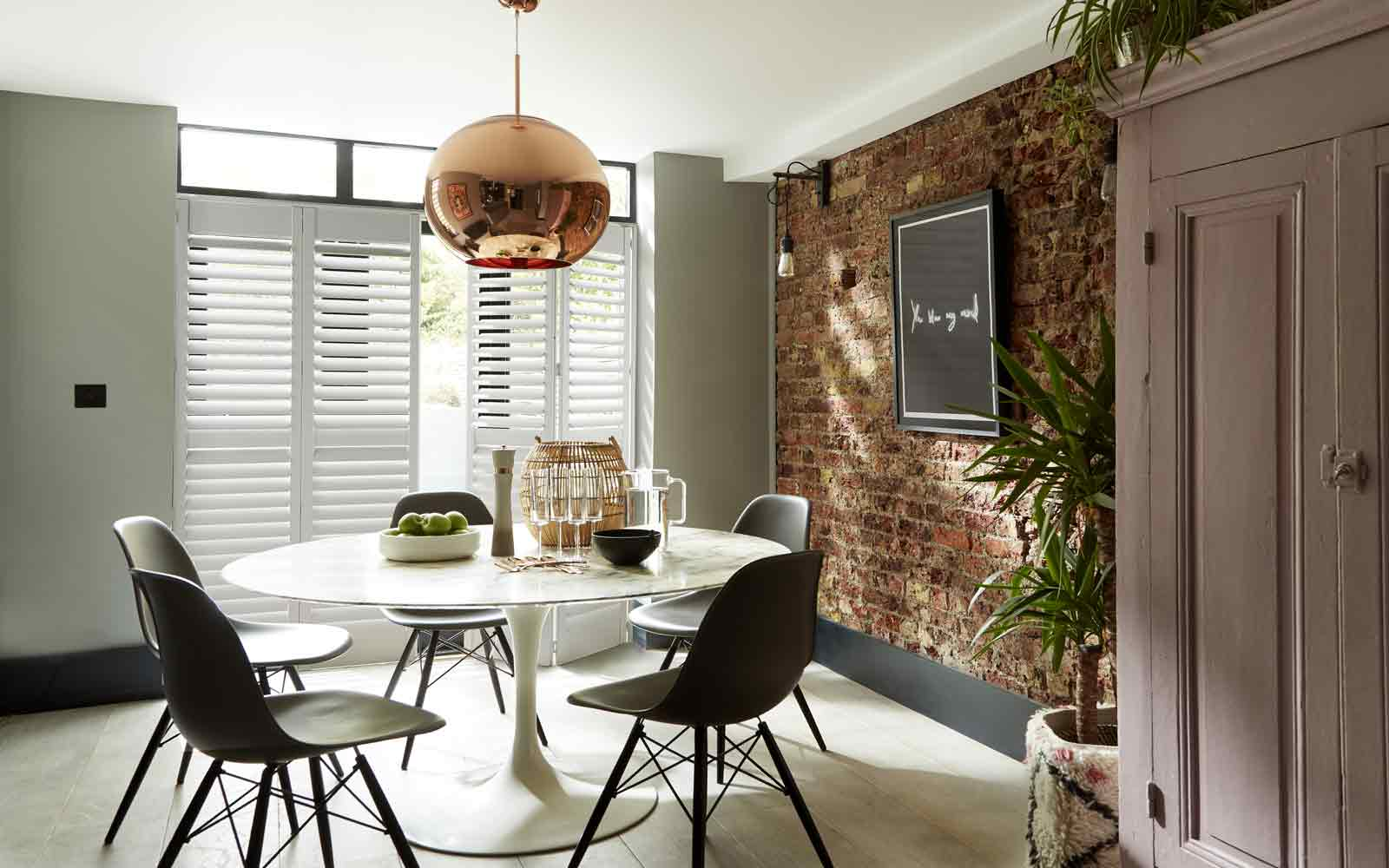 Bi-Fold Shutters Tracked Doors in a Dining Room