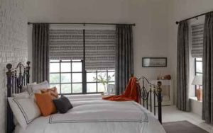 Roman Blinds and Curtains In A Bedroom