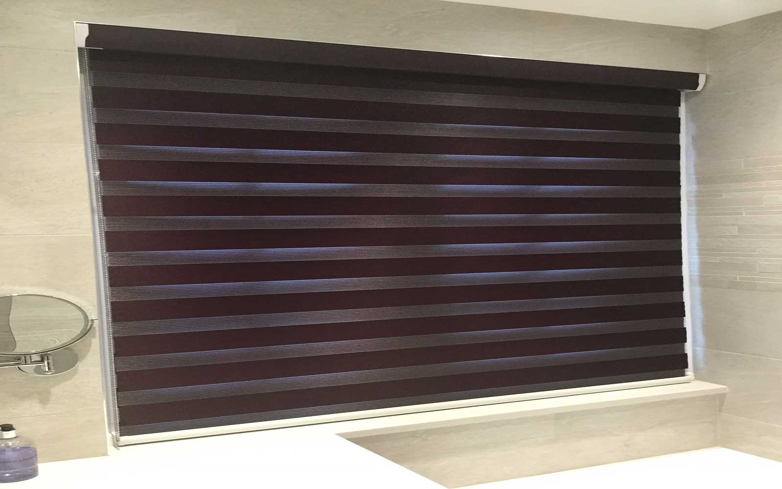 Closed Duo Fabric Roller Blinds In A Bathroom