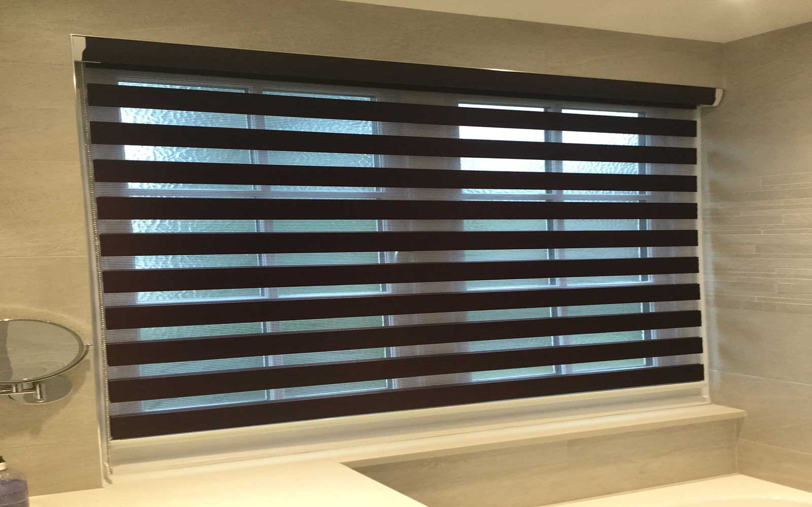 Open Duo Fabric Roller Blinds In A Bathroom