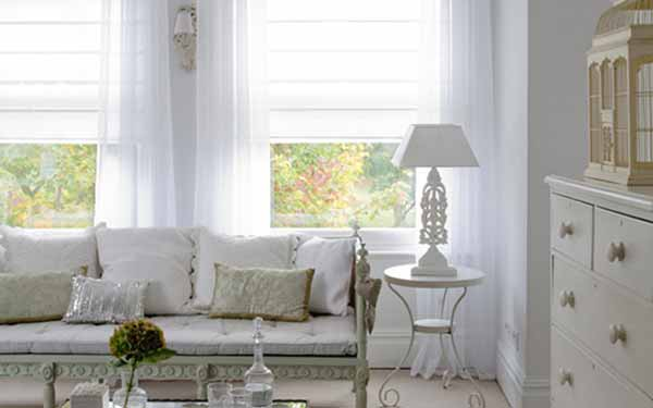 Voile Roman Blinds In A Living Room