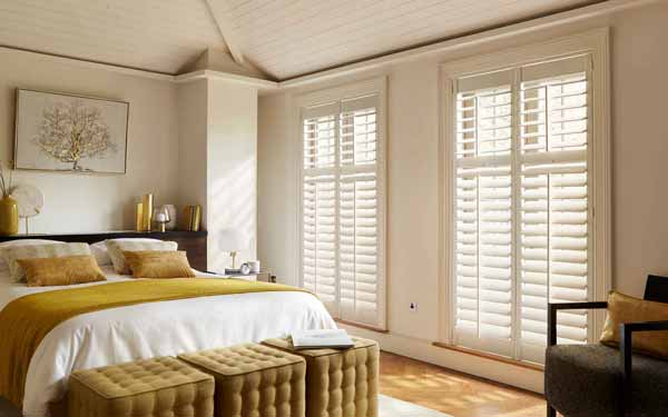 Full Height Plantation Shutters In A Bedroom
