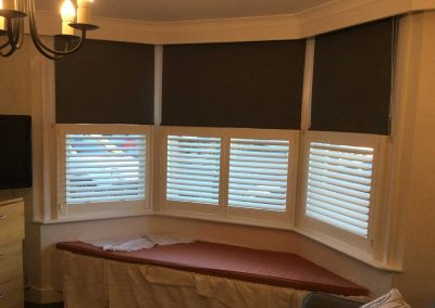 Roller Blinds and Cafe Style Plantation Shutters in a Bay