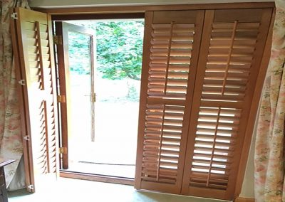 Tracked Door Plantation Shutters Stained