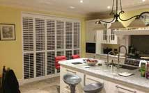 Bi-Fold Tracked Door Plantation Shutters In A Kitchen